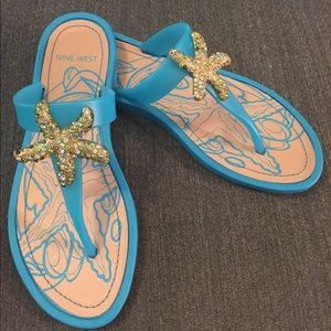 Nine West turquoise starfish sandals.